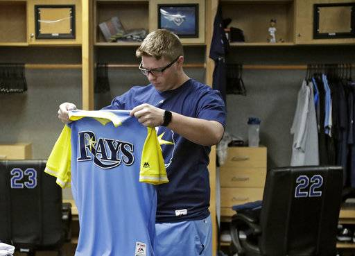 Tampa Bay Rays clubhouse attendant Jonah McElwee packs starting pitcher Chris Archer's uniforms in the clubhouse, Monday, Oct. 2, 2017, in St. Petersburg, Fla. The Rays finished their season Sunday ending with an 80-82 record.