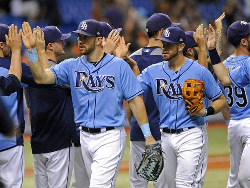 Tampa Bay Rays' Steven Souza Jr., left, and Evan Longoria, right, celebrate with teammates after defeating the Baltimore Orioles in a baseball game Sunday, Oct. 1, 2017, in St. Petersburg, Fla.