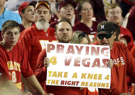 A fan holds a Praying for Vegas sign before an NFL football game between the Kansas City Chiefs and the Washington Redskins in Kansas City, Mo., Monday, Oct. 2, 2017.