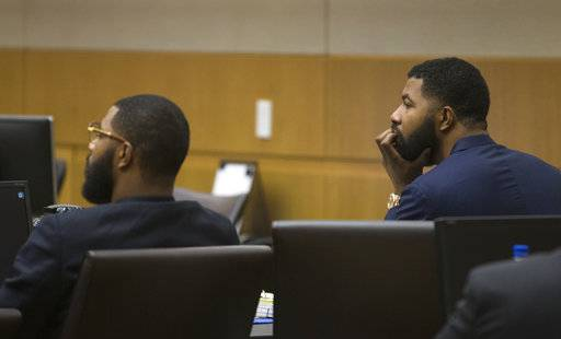 Marcus Morris, left, and Markieff Morris attend closing arguments Monday, Oct. 2, 2017, in Maricopa County Superior Court in Phoenix. The Morris brothers are accused of helping three other people beat Erik Hood two years ago. (Mark Henle/The Arizona Republic via AP)