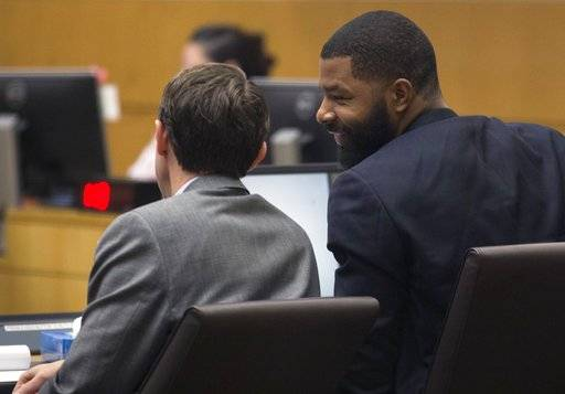 Marcus Morris, right, talks with his attorney Tim Eckstein, Monday, Oct. 2, 2017, during his and his brother Markieff's trial in Maricopa County Superior Court in Phoenix. The Morris brothers are accused of helping three other people beat Erik Hood two years ago. (Mark Henle/The Arizona Republic via AP)