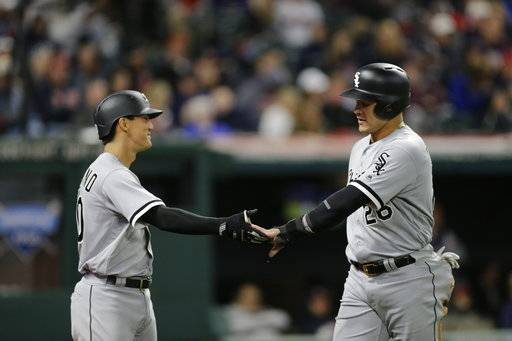 Chicago White Sox's Avisail Garcia, right, is congratulated by Tyler Saladino after scoring on a one-run double hit by Kevan Smith in the sixth inning of a baseball game against the Cleveland Indians, Saturday, Sept. 30, 2017, in Cleveland.