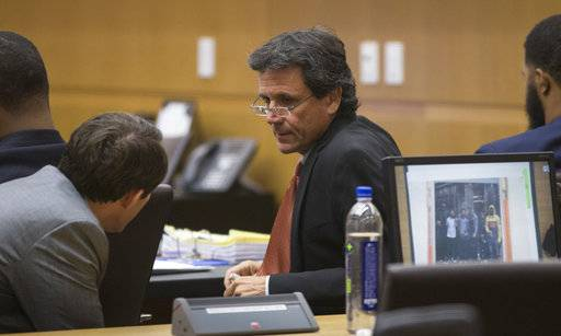 Attorney James Belanger, center, talks with attorney Tim Eckstein, left, during closing arguments in the Marcus and Markieff Morris trial Monday, Oct. 2, 2017, in Maricopa County Superior Court in Phoenix. The Morris brothers are accused of helping three other people beat Erik Hood two years ago. (Mark Henle/The Arizona Republic via AP)