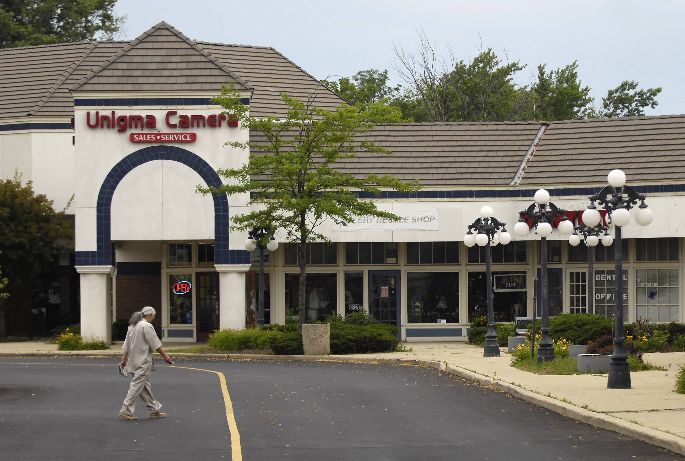 The owners of the International Plaza shopping center on Golf Road east of Arlington Heights Road are willing to sell the 13-acre site or have it redeveloped, according to village officials, who are hiring a consultant to assess market conditions in the area.