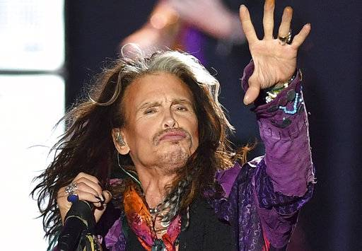 "FILE - In this May 26, 2017, file photo, singer Steven Tyler performs during an Aerosmith concert at the Koenigsplatz in Munich, Germany. In a statement posted to the band's website on Oct. 2, 2017, Tyler disputed rumors about his health surrounding an early end to the band's tour, saying he ""certainly did not have a heart attack or seizure.�"