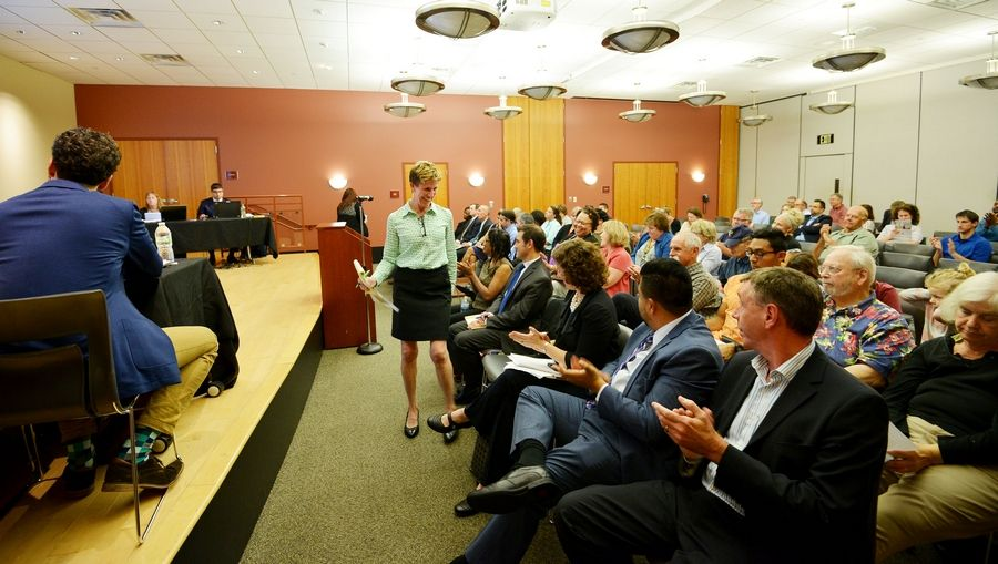 Kerry Kelley, president of the Elgin Charter School Initiative, gets applause after speaking to the Illinois State Charter School Commission board Tuesday during a public hearing about the group's charter school proposal. The state panel granted a 5-year charter for the school to open in August 2018.