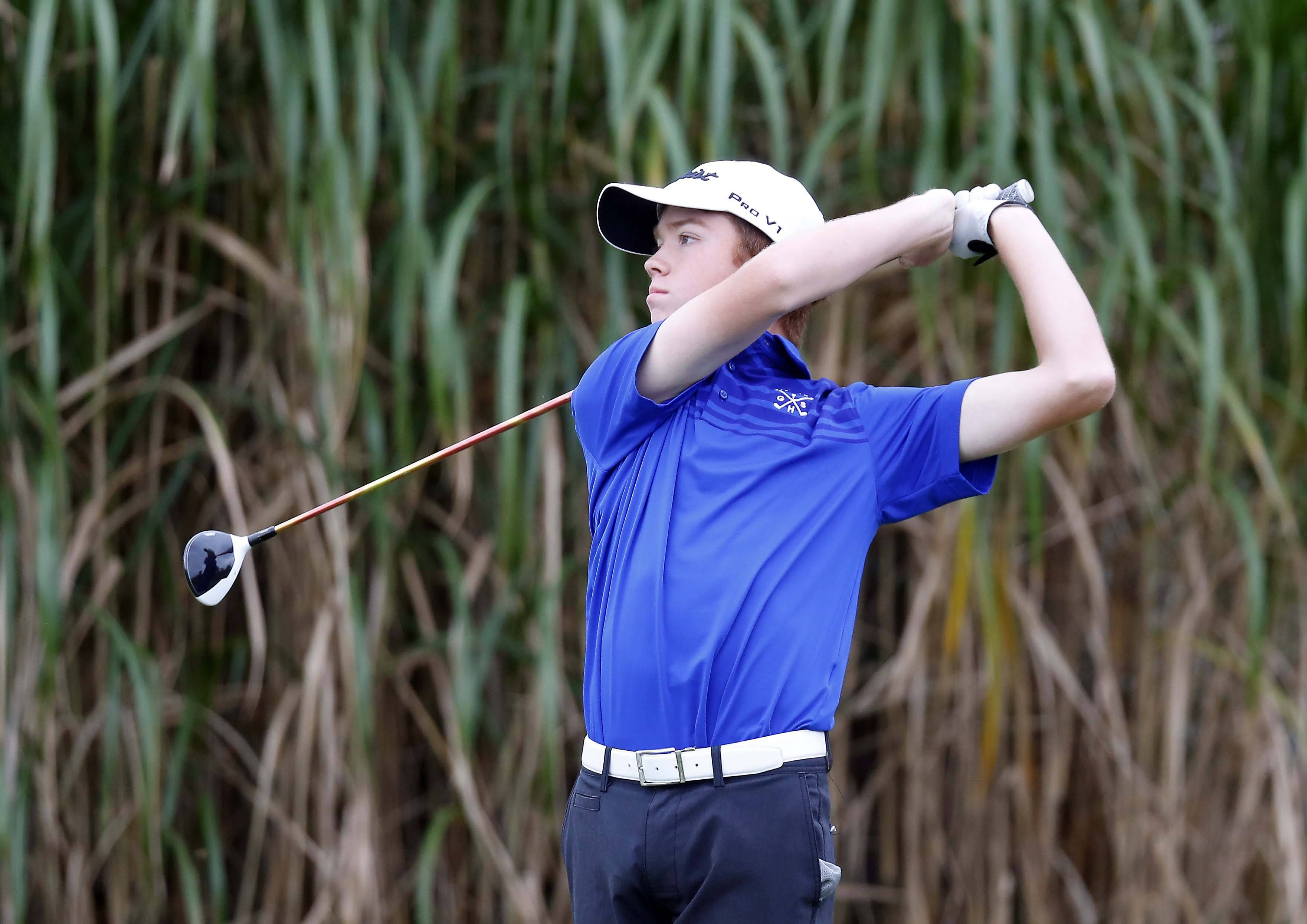 Geneva's Tyler Isenhart on the third tee Tuesday during the Geneva boys golf regional at Mill Creek Golf Club. Isenhart's medalist round of 71 led the Vikings to the regional title.