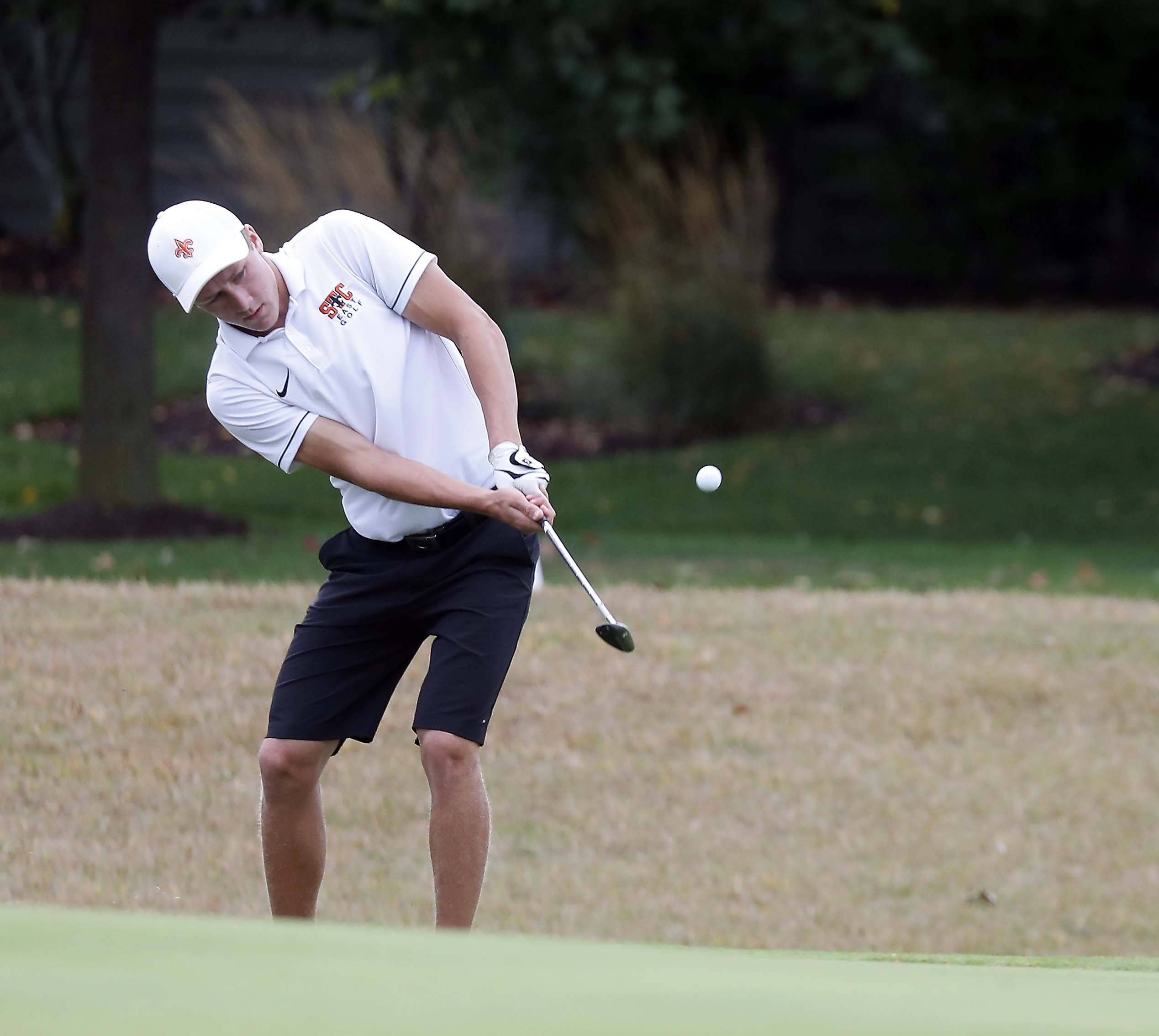 St. Charles East's Mason Meadows chips to the second green Tuesday during the Geneva boys golf regional at Mill Creek Golf Club.
