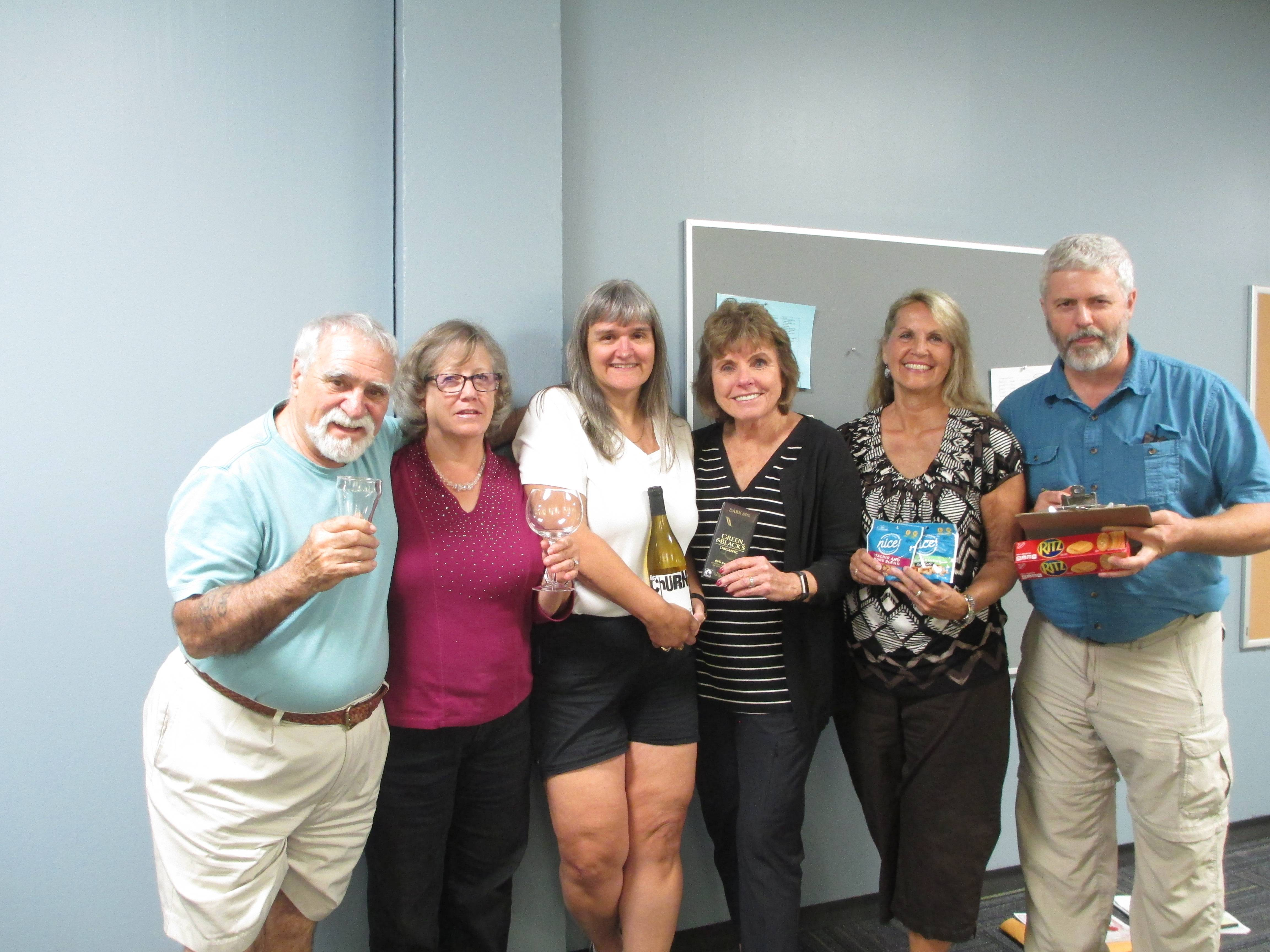 Members of The Festival Chorus Ways and Means Committee plan for the October 14 Wine Tasting. Pictured left to right are Chip LaCasse, Cathy Myles, Monica Kort, Maddie Barrett, Marcy Heston and Jamie Myles