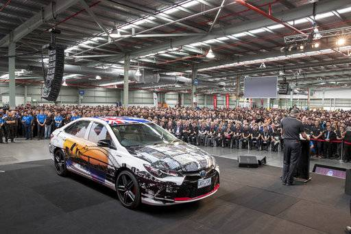 In this photo provided by Toyota Australia the last Toyota car produced in Australia is displayed for gathered workers in Melbourne, Tuesday, Oct. 3, 2017. Toyota closed its manufacturing plant in Melbourne, ending 54 years of production by the Japanese firm in Australia, the first country outside of Japan where the company made cars. (Toyota Australia via AP)
