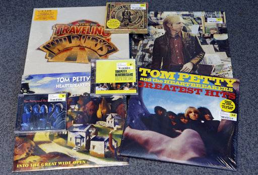 Tom Petty albums are shown at the Rock and Roll Hall of Fame, Monday, Oct. 2, 2017, in Cleveland. With his death at age 66, rock 'n' roll loses a man who carried the torch proudly for four decades in the public eye. Petty burst onto the scene with the punk rock generation, but he was a rock classicist to the core.