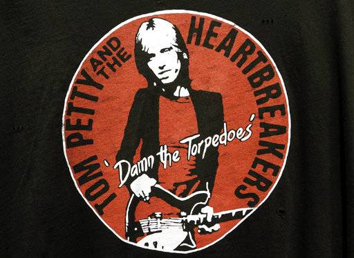 A close-up of a Tom Petty and the Heartbreakers t-shirt rests on a hanger at the Rock and Roll Hall of Fame, Monday, Oct. 2, 2017, in Cleveland. With his death at age 66, rock 'n' roll loses a man who carried the torch proudly for four decades in the public eye. Petty burst onto the scene with the punk rock generation, but he was a rock classicist to the core.