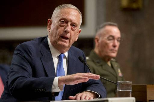 Defense Secretary Jim Mattis, left, accompanied by Joint Chiefs Chairman Gen. Joseph Dunford, speaks on Afghanistan before the Senate Armed Services Committee on Capitol Hill in Washington, Tuesday, Oct. 3, 2017.