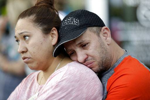 Rosa and Alan Duarte become emotional during a vigil at City Hall in Las Vegas, Monday, Oct. 2, 2017. The vigil was held in honor of the over 50 people killed and hundreds injured in a mass shooting at an outdoor music concert late Sunday.