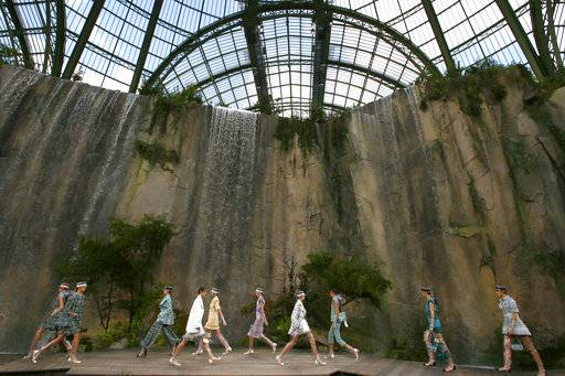 Models wear creations for the Chanel Spring/Summer 2018 ready-to-wear fashion collection presented in Paris, Tuesday, Oct., 2017.