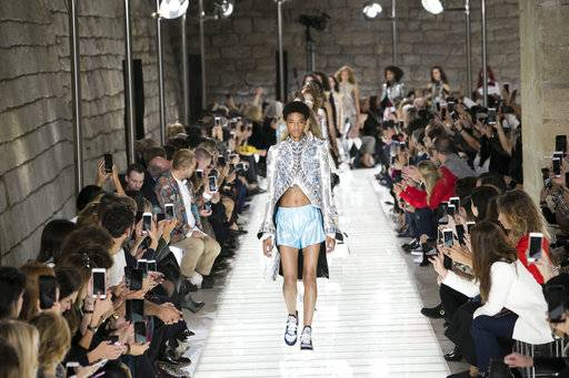 Models wear creations for Louis Vuitton's Spring-Summer 2018 ready-to-wear fashion collection presented Tuesday, Oct. 3, 2017 in Paris.