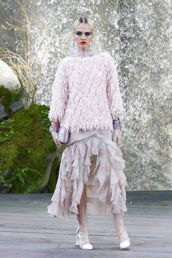 A model wears a creation for the Chanel Spring/Summer 2018 ready-to-wear fashion collection presented in Paris, Tuesday, Oct., 2017.