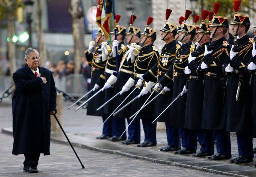 FILE - In this Nov. 17, 2009 file photo, then Iraqi President Jalal Talabani, center, reviews French troops at the Tomb of the Unknown Soldier, in Paris,France. Talabani, a lifelong fighter for Iraq's Kurds who rose to become the country's president, presenting himself as a unifying father figure to temper the potentially explosive hatreds among Kurds, Shiites and Sunnis has died in a Berlin hospital at the age of 83.