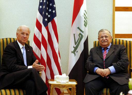 FILE - In this July 5, 2010 file photo, then U.S. Vice President Joe Biden, left, meets with then Iraqi President Jalal, Talabani, right, in Baghdad, Iraq. Talabani, a lifelong fighter for Iraq's Kurds who rose to become the country's president, presenting himself as a unifying father figure to temper the potentially explosive hatreds among Kurds, Shiites and Sunnis has died in a Berlin hospital at the age of 83.