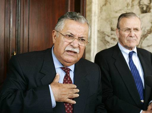 FILE - In this April 12, 2005 file photo, then Iraqi President Jalal Talibani, left, and tehn U.S. Secretary of Defense Donald Rumsfeld talk at a press availability in Baghdad, Iraq. Talabani, a lifelong fighter for Iraq's Kurds who rose to become the country's president, presenting himself as a unifying father figure to temper the potentially explosive hatreds among Kurds, Shiites and Sunnis has died in a Berlin hospital at the age of 83.