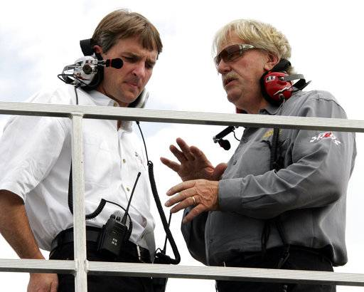 FILE - In this May 25, 2006, file photo, team owner Robert Yates, right, talks with his son Doug Yates, left, during practice for Sunday's NASCAR Nextel Cup Coca-Cola 600 auto race at Lowe's Motor Speedway in Concord, N.C. Robert Yates, a longtime NASCAR owner and engine builder, has died, Doug Yates said on Twitter Monday, Oct. 2, 2017. He was 74.
