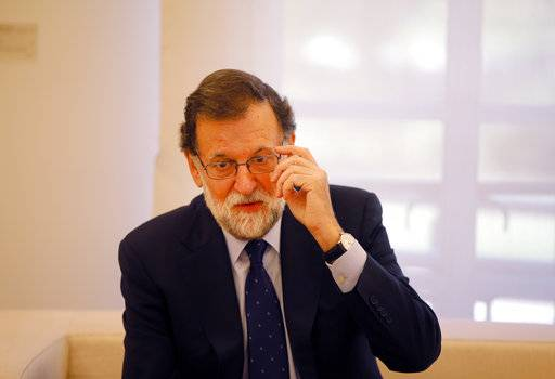 Spain's Prime Minister Mariano Rajoy gestures before a meeting with Spain's main opposition Socialist leader Pedro Sanchez at the Moncloa Palace in Madrid, Spain, Monday Oct. 2, 2017. Rajoy met with Sanchez to discuss Spain's options before seeking a parliamentary session to discuss how to confront the country's most serious crisis in decades after Catalonia's referendum Sunday on breaking away from Spain.