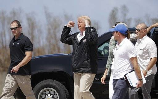 President Donald Trump gestures after arriving at the Luis Muñiz Air National Guard Base in San Juan, Puerto Rico, Tuesday, Oct. 3, 2017. Trump is visiting Puerto Rico in the wake of Hurricane Maria.