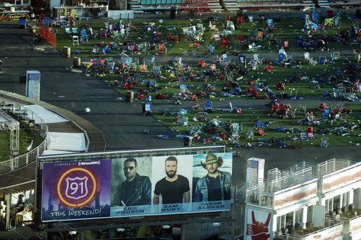 Debris litters a festival grounds across the street from the Mandalay Bay resort and casino Tuesday, Oct. 3, 2017, in Las Vegas. Authorities said Stephen Craig Paddock broke windows on the casino and began firing with a cache of weapons, killing dozens and injuring hundreds at a music festival at the grounds.