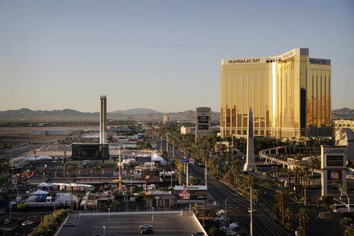 The Mandalay Bay resort and casino, right, overlooks an outdoor festival grounds across the street, left, Tuesday, Oct. 3, 2017, in Las Vegas. Authorities said Stephen Craig Paddock broke the windows on the casino and began firing with a cache of weapons, killing dozens and injuring hundreds at a music festival at the grounds.