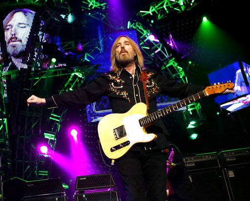 FILE - In this June 17, 2008 file photo, Tom Petty performs with The Heartbreakers at Madison Square Garden in New York. Petty has died at age 66. Spokeswoman Carla Sacks says Petty died Monday night, Oct. 2, 2017, at UCLA Medical Center in Los Angeles after he suffered cardiac arrest.