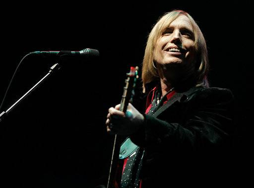 FILE - In this June 16, 2006 file photo, Tom Petty performs at the Bonnaroo Music & Arts Festival in Manchester, Tenn. Petty has died at age 66. Spokeswoman Carla Sacks says Petty died Monday night, Oct. 2, 2017, at UCLA Medical Center in Los Angeles after he suffered cardiac arrest.