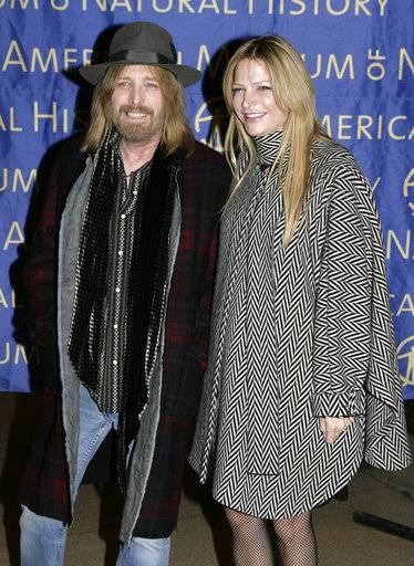 FILE - In this Nov. 15, 2007 file photo, Tom Petty and his wife Dana arrive for the gala at the American Museum of Natural History in New York. Petty has died at age 66. Spokeswoman Carla Sacks says Petty died Monday night, Oct. 2, 2017, at UCLA Medical Center in Los Angeles after he suffered cardiac arrest.