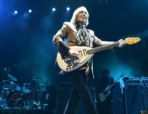 FILE - In this Oct. 4, 2006 file photo, singer Tom Petty performs in Glendale, Ariz. Petty has died at age 66. Spokeswoman Carla Sacks says Petty died Monday night, Oct. 2, 2017, at UCLA Medical Center in Los Angeles after he suffered cardiac arrest.