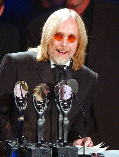 FILE - In this March 18, 2002 file photo, Tom Petty, of the band Tom Petty and the Heart Breakers, speaks after being inducted at the Rock and Roll Hall of Fame induction ceremony in New York. Petty has died at age 66. Spokeswoman Carla Sacks says Petty died Monday night, Oct. 2, 2017, at UCLA Medical Center in Los Angeles after he suffered cardiac arrest.