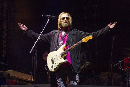 FILE - In this Sept. 17, 2017, file photo, Tom Petty of Tom Petty and the Heartbreakers appears at KAABOO 2017 in San Diego, Calif. Petty has died at age 66. Spokeswoman Carla Sacks says Petty died Monday night, Oct. 2, 2017, at UCLA Medical Center in Los Angeles after he suffered cardiac arrest. (Photo by Amy Harris/Invision/AP, File)