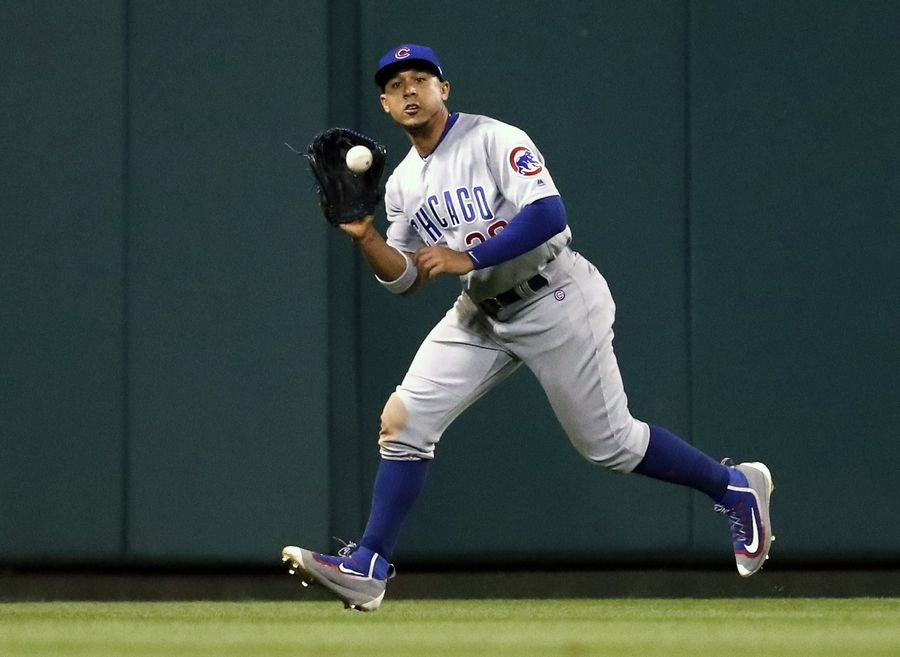 Chicago Cubs center fielder Jon Jay catches a fly ball by St. Louis Cardinals' Paul DeJong to end the fourth inning of a baseball game Wednesday, Sept. 27, 2017, in St. Louis.