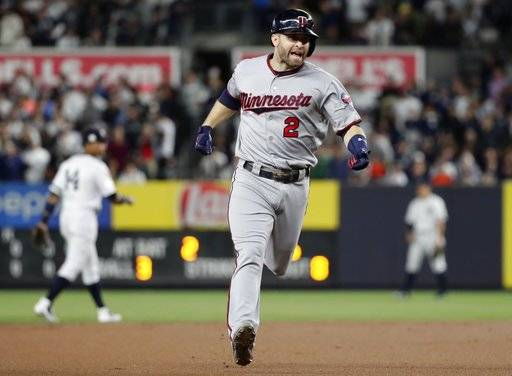Minnesota Twins' Brian Dozier runs the bases after hitting a home run against the New York Yankees during the first inning of the American League wild-card baseball game Tuesday, Oct. 3, 2017, in New York.