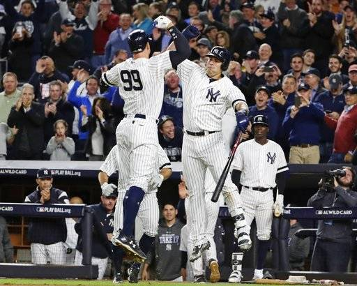 New York Yankees' Aaron Judge (99) celebrates with Gary Sanchez after hitting a two-run home run during the fourth inning of the American League wild-card baseball game against the Minnesota Twins on Tuesday, Oct. 3, 2017, in New York.