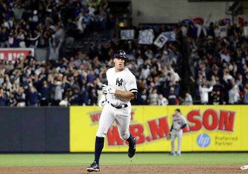 New York Yankees' Aaron Judge runs the bases after hitting a two-run home run during the fourth inning of the American League wild-card baseball game against the Minnesota Twins on Tuesday, Oct. 3, 2017, in New York.