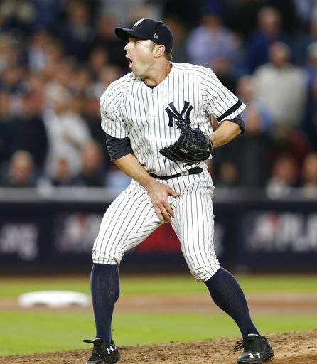New York Yankees relief pitcher David Robertson reacts after Yankees catcher Gary Sanchez was hit by a foul tip of during the sixth inning an American League wild-card playoff baseball game against the Minnesota Twins in New York, Tuesday, Oct. 3, 2017.