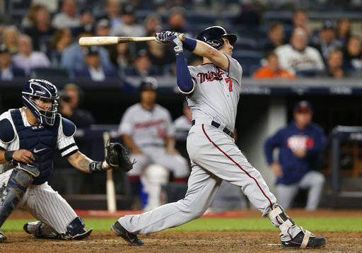 Minnesota Twins' Joe Mauer flies out to left with runners on first and second during the sixth inning of the American League wild-card playoff baseball game against the New York Yankees in New York, Tuesday, Oct. 3, 2017. Yankees catcher Gary Sanchez is at left.