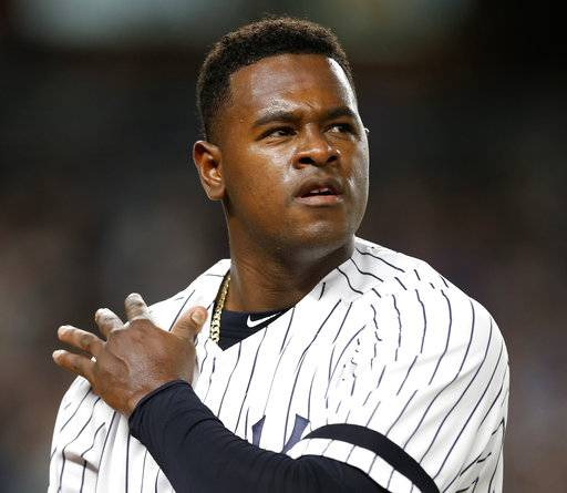 New York Yankees starting pitcher Luis Severino walks off the field after being removed during the first inning game of the American League wild-card playoff baseball game against the Minnesota Twins in New York, Tuesday, Oct. 3, 2017. Severino had given up a solo home run and a two-run homer.