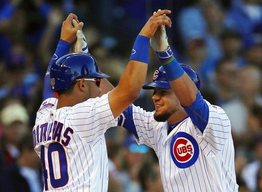 Chicago Cubs' Kyle Schwarber, right, celebrates with teammate Willson Contreras after hitting a two-run home run against the Cincinnati Reds during the second inning of a baseball game Saturday, Sept. 30, 2017, in Chicago.