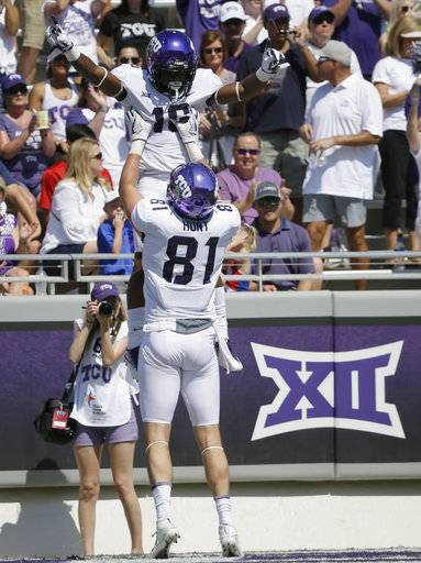FILE - In this Sept. 16, 2017, file photo, TCU running back Kenedy Snell (16) celebrates his touchdown with teammate tight end Cole Hunt (81) during the first half an NCAA college football game against SMU in Fort Worth, Texas. While the Frogs are 4-0, with impressive road wins at Arkansas and then-No. 6 Oklahoma State in the last game before their open date, there is still a lot of unblemished white space on that pyramid of goals waiting to be shaded in purple.
