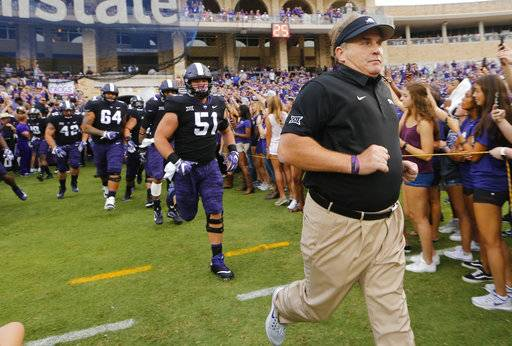 FILE- In this Sept. 2, 2017, file photo, TCU head coach Gary Patterson runs onto the field before an NCAA college football game against Jackson State in Fort Worth.  While the Frogs are 4-0, with impressive road wins at Arkansas and then-No. 6 Oklahoma State in the last game before their open date, there is still a lot of unblemished white space on that pyramid of goals waiting to be shaded in purple. (Rodger Mallison/Star-Telegram via AP, File)