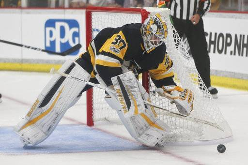 FILE - In this Sept. 24, 2017, file photo, Pittsburgh Penguins goalie Matt Murray controls the puck as he plays against the St. Louis Blues during the second period of the NHL preseason hockey game in Cranberry, Pa. There are no more questions about who the No. 1 goaltender is in Pittsburgh anymore. The job is Matt Murray's for the foreseeable future, a burden the 23-year-old two-time Stanley Cup winner is only too happy to carry.