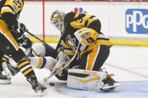 FILE - In this Sept. 24, 2017, file photo, Pittsburgh Penguins goalie Matt Murray makes a save on the St. Louis Blues during the second period of the NHL preseason hockey game in Cranberry, Pa. There are no more questions about who the No. 1 goaltender is in Pittsburgh anymore. The job is Matt Murray's for the foreseeable future, a burden the 23-year-old two-time Stanley Cup winner is only too happy to carry.