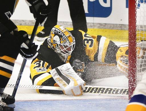 FILE - In this Sept. 24, 2017, file photo, the puck is in front of Pittsburgh Penguins goalie Matt Murray as he makes a save against the St. Louis Blues during the second period of the NHL preseason hockey game in Cranberry, Pa. There are no more questions about who the No. 1 goaltender is in Pittsburgh anymore. The job is Matt Murray's for the foreseeable future, a burden the 23-year-old two-time Stanley Cup winner is only too happy to carry.