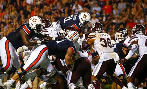 Auburn running back Kerryon Johnson (21) dives over the top for a touchdown in an NCAA college football game against Mississippi State, Saturday, Sept. 30, 2017, in Auburn, Ala.