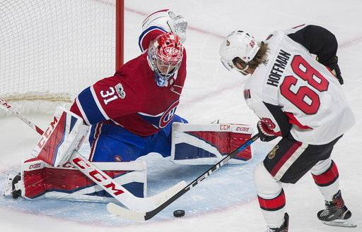 Montreal Canadiens goaltender Carey Price makes a save against Ottawa Senators' Mike Hoffman during the second period of an NHL preseason hockey game in Montreal, Saturday, Sept. 30, 2017. (Graham Hughes/The Canadian Press via AP)